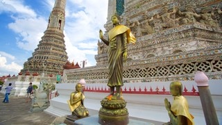 Wat Arun which includes a temple or place of worship, religious elements and a statue or sculpture
