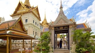 Grand Palace showing a temple or place of worship as well as a small group of people