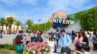 Universal Studios Japan® which includes a statue or sculpture as well as a large group of people