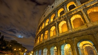 Colosseum showing a ruin and night scenes