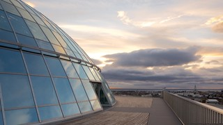 Perlan featuring a sunset and modern architecture