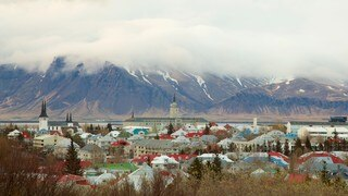 Perlan which includes mountains, mist or fog and a small town or village