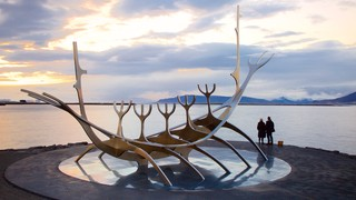 Solfar which includes a sunset, general coastal views and outdoor art