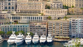 Monaco Harbour showing a marina, a bay or harbor and a coastal town