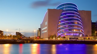 The Convention Centre Dublin which includes a river or creek, a city and a sunset