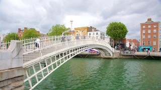 Ha\' Penny Bridge showing a bridge, a city and a river or creek