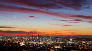 Mt. Coot-Tha showing a city, a sunset and central business district