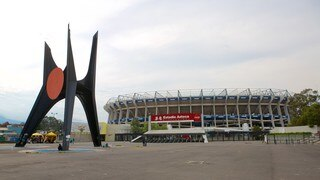 Estadio Azteca featuring a statue or sculpture and a square or plaza