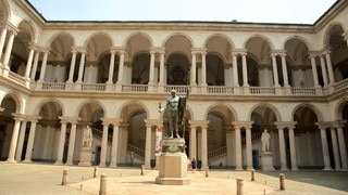 Pinacoteca di Brera featuring heritage architecture and a statue or sculpture
