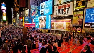 Times Square which includes night scenes, nightlife and a square or plaza