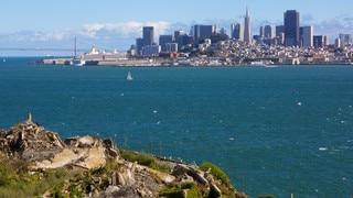 Alcatraz Island showing island views, landscape views and a skyscraper