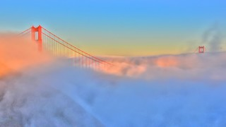 Golden Gate Bridge showing a bridge and mist or fog