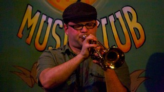 Frenchmen Street Jazz Clubs showing performance art and music as well as an individual male