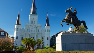 Jackson Square which includes a city, a square or plaza and a statue or sculpture