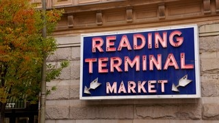 Reading Terminal Market featuring markets and signage
