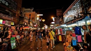 Khao San Road which includes night scenes, markets and a city