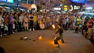 Khao San Road which includes street performance, street scenes and night scenes