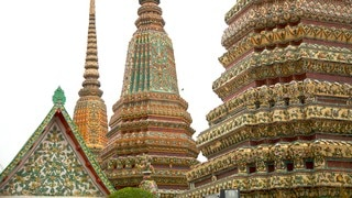 Wat Pho which includes a temple or place of worship and heritage architecture