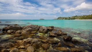 Kata Noi Beach showing rocky coastline, tropical scenes and landscape views