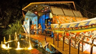 Phuket Fantasea featuring a fountain, street performance and performance art