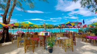 Kamala Beach which includes landscape views, tropical scenes and a luxury hotel or resort