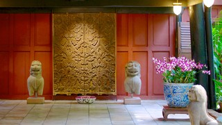 Jim Thompson House which includes a house, flowers and interior views