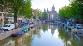 Red Light District which includes a city, a lake or waterhole and heritage architecture