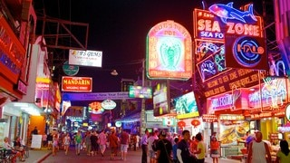 Walking Street which includes night scenes, a city and signage