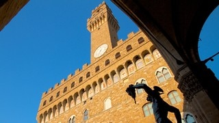 Uffizi Gallery which includes a statue or sculpture, heritage architecture and chateau or palace