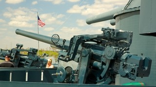 Battleship Texas which includes general coastal views, military items and a marina