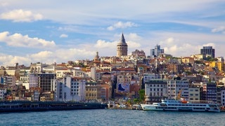 Galata Tower which includes a marina, general coastal views and a city