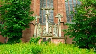 Frankfurt Cathedral which includes a statue or sculpture, a church or cathedral and religious aspects