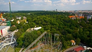 Wiener Prater which includes a city, rides and forests
