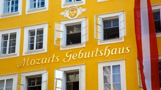 Mozart\'s Birthplace featuring signage
