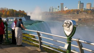 Niagara Falls State Park which includes a waterfall and views as well as a small group of people