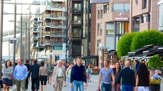 Aker Brygge which includes a city and street scenes as well as a large group of people