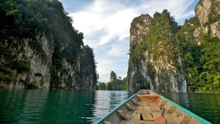 Khao Lak showing a lake or waterhole, boating and mountains