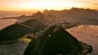 Sugar Loaf Mountain featuring a coastal town, a sunset and mountains