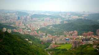 Maokong Gondola featuring a city
