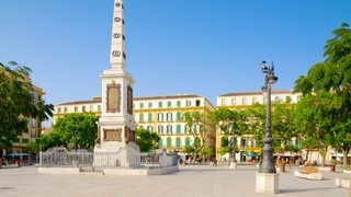 Plaza de la Merced which includes a city, a square or plaza and a monument