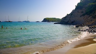 Cala Jondal Beach featuring a sandy beach, landscape views and swimming