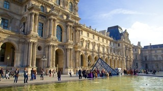 Louvre Museum featuring heritage architecture, a square or plaza and modern architecture