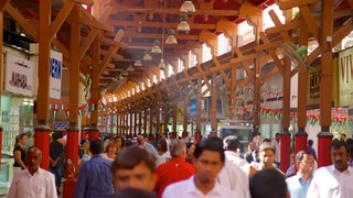Gold Souk which includes interior views as well as a large group of people