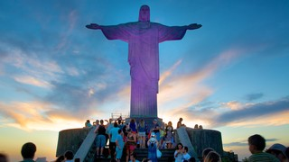 Corcovado which includes a sunset, religious aspects and a statue or sculpture