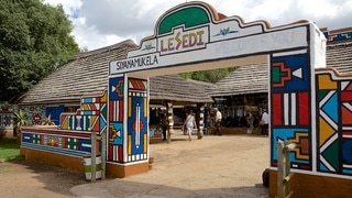 Lesedi Cultural Village featuring a small town or village and signage