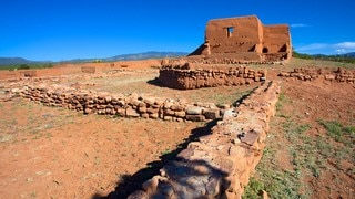 Pecos National Historical Park featuring tranquil scenes and building ruins