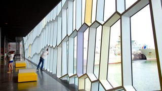 Harpa featuring modern architecture and interior views as well as a small group of people