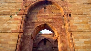 Qutub Minar which includes a temple or place of worship and heritage architecture