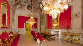 Palazzo Comunale featuring interior views, chateau or palace and heritage elements