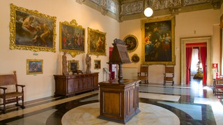 Palazzo Comunale featuring chateau or palace, heritage elements and interior views